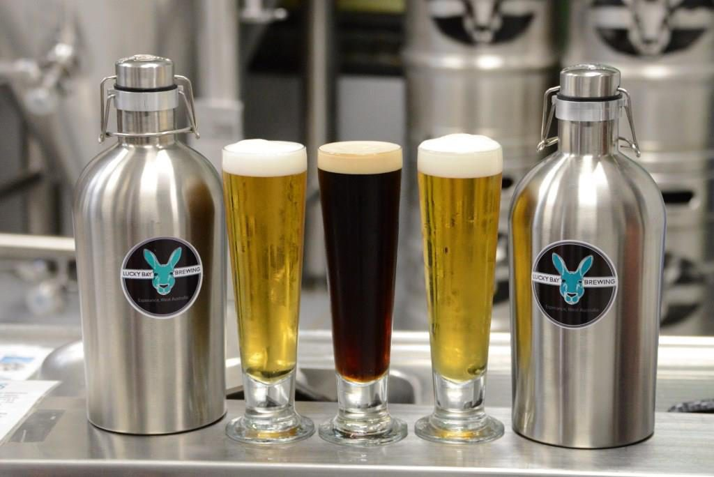 Three of Lucky Bay Brewing's beers with growler