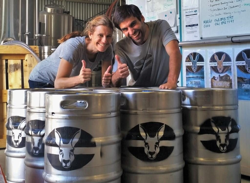 Lucky Bay Brewing owners with their first kegs of beer